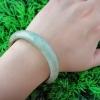 5B40JA กำไลหยกพม่าแท้สีเขียวอ่อนติดเนื้อพีเมี่ยมครึ่งวง สีสวยหวานเนื้อเทียนสวย หยินหยางเขียวหวานครึ่งเขียวขี้ม้า 5.8 cm.