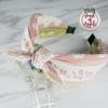 ที่คาดผมมัดปมหูกระต่ายสีชมพูขาวลายดอกไม้