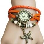 นาฬิกาข้อมือผู้หญิง นาฬิกา สายหนังถัก สไตล์วินเทจ สีส้ม จี๊ด ห้อยจี้รูป ดาว ของขวัญ น่ารัก ๆ ให้แฟน no 64810