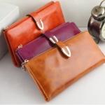 กระเป๋าสตางค์ผู้หญิง ใบยาว กระเป๋าสตางค์ หนังวัว แท้ 100 เปอร์เซนต์ ยิ่งใช้ยิ่งสวย แข็งแรงทนทาน ใช้จนลืม ดีไซน์ซิปนอก มีกระดุมรัด 223016