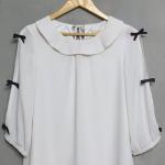 เสื้อชีฟองสีขาวติดโบว์สีดำที่แขน