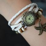 นาฬิกาข้อมือ ผู้หญิง นาฬิกาสายหนังถัก สไตล์สร้อยข้อมือ วินเทจ สุด ๆ สีขาว ห้อยจี้ รูป ปลาดาว เท่ เก๋ อย่างมีสไตล์ 799462
