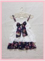 blouse2134 เสื้อแฟชั่นสายเดี่ยวผ้านิ่มสีขาว แต่งโบว์อกและชายระบายลายดอกไม้โทนสีน้ำเงิน