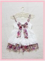 blouse2133 เสื้อแฟชั่นสายเดี่ยวผ้านิ่มสีขาว แต่งโบว์อกและชายระบายลายดอกไม้โทนสีม่วงครีม