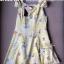 พร้อมส่ง - Size M Lady Daisy Ribbon Off-shoulder Mini dress : มินิเดรสเปิดไหล่โบว์ลายดอกเดซี่โทนสีเหลือง thumbnail 9