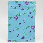 ซองซิปลายดอกไม้สีม่วง พื้นหลังสีฟ้า ขนาด 8x12 cm. 100 ชิ้น