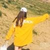 เสื้อแฟชั่น คอกลม แขนยาว หลังแต่งอักษร สีเหลือง