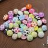 กระดุมพลาสติก รูปลูกฟุตบอล คละสี ขนาด 15 mm. (แพ็ค 11 ชิ้น)