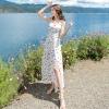 ชุดเดรสยาวเที่ยวทะเลสีขาว สายเดี่ยว ผูกโบว์ แฟชั่นเที่ยวทะเลสวยๆสไตล์ฮาวาย
